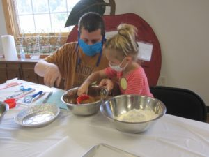 Father and daughter measuring sugar